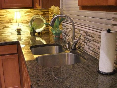 Updating: tropical brown granite counters with travertine