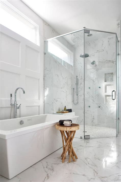 Contemporary Master Bath With White Marble and Glass